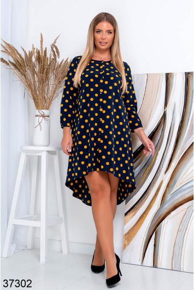 Синє стильне плаття в горох для повних жінок