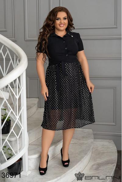 Чорне нарядне стильне плаття в горох для повних жнок