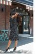 Чорне осіннє плаття міді з квітковим принтом