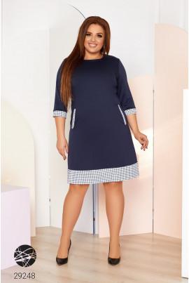Темно-синє практичне трикотажне плаття з кишенями для повних жінок