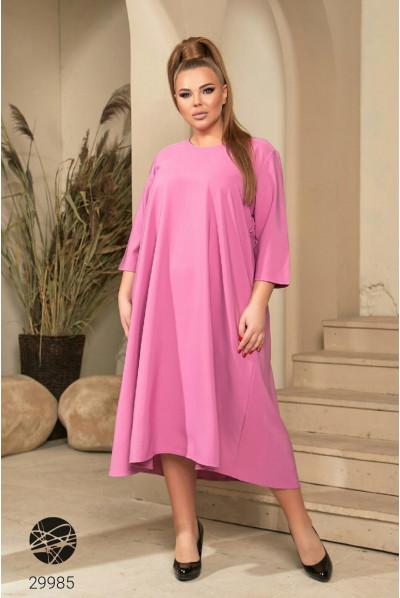 Рожеве просторе плаття для жінок з пишними формами
