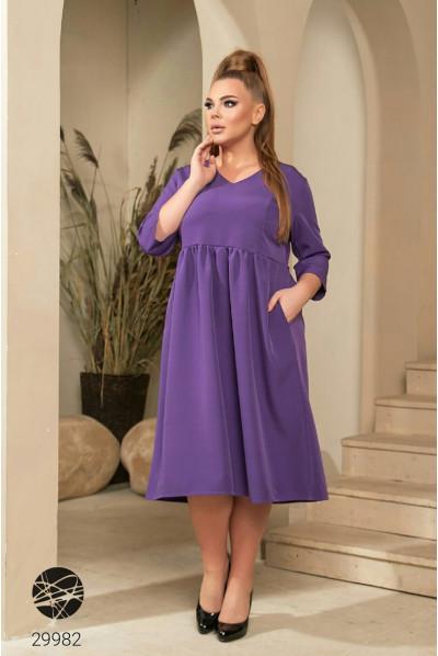 Фіолетове вишукане жіночне плаття великих розмірів