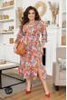 Помаранчеве яскраве квіткове плаття з високим розрізом