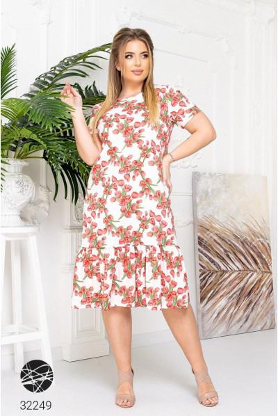 Біле грайливе квіткове плаття з оборко