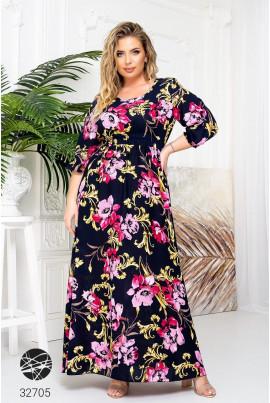 Чорна ефектна довга сукня з яскравим квітковим принтом