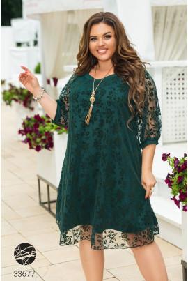 Зелена тендітна приваблива сукня міді