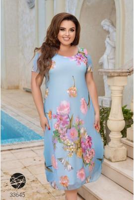 Блакитна літня шифонова сукня з різнобарвним квітковим принтом