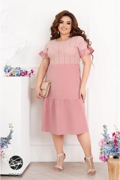 Рожеве стильне жіноче плаття міді з перфорацією