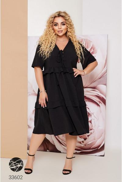 Чорна неймовірно приваблива сукня міді