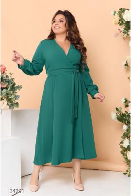Зелена ошатна жіноча сукня міді на запах