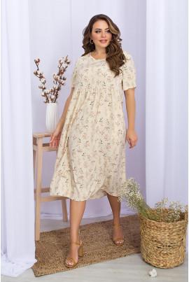 Молочна ніжна сукня міді з флористичним принтом