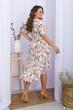 Біла ошатна сукня на запах для повних жінок