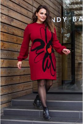 В'язане плаття червоного кольору з яскравою квіткою
