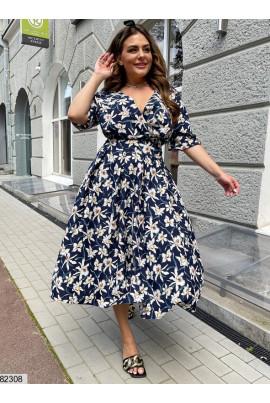Синє трендове квіткове плаття для жінок з апеитними формами