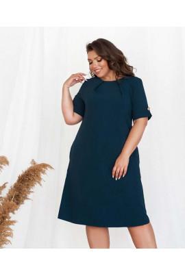 Синє оригінальне плаття з кишенями