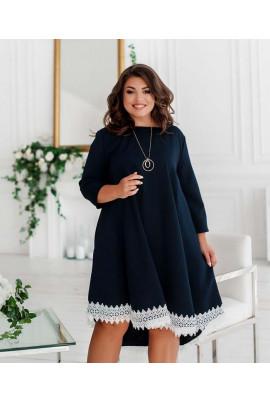 Темно-синє асиметричне плаття для повних жінок