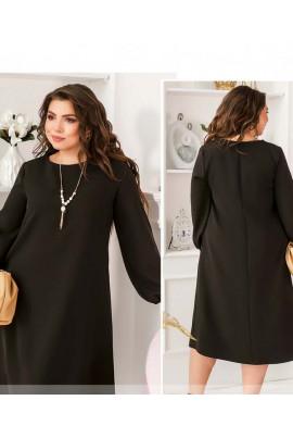 Чорна мінімалістична сукня міді з прикрасою