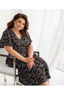 Чорна зручна лаконічна сукня з кишенями