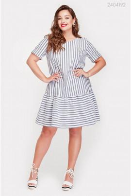 Модне сіро-біле плаття великого розміру
