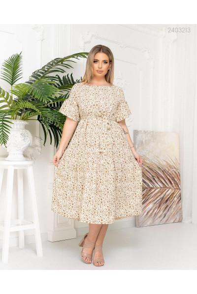 Бежева елегантна витончена сукня міді з принтом