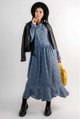 Блакитна зачаовуюча витончена сукня міді