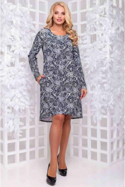 Плаття а-силуету з асиметричним низом і квітковим принтом