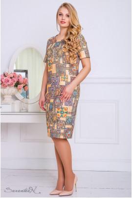 Бежеве привабливе плаття з оригінальним принтом