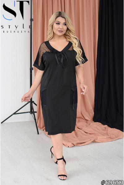 Чорна приваблива сукня з напівпрозорими вставками