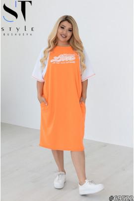 Помаранчеве грайливе яскраве плаття великих розмірів