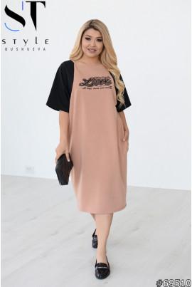 Бежево-чорне комфортне жіноче плаття міді