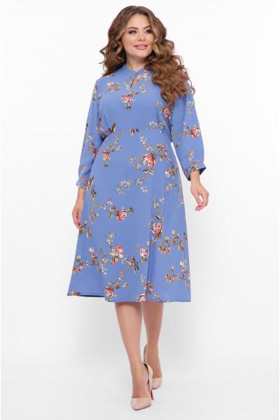 Блакитна неймовірно елегантна сукня міді з принтом