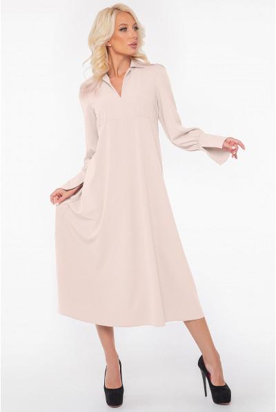 Мінімалістична жіноча сукня міді молочного кольору
