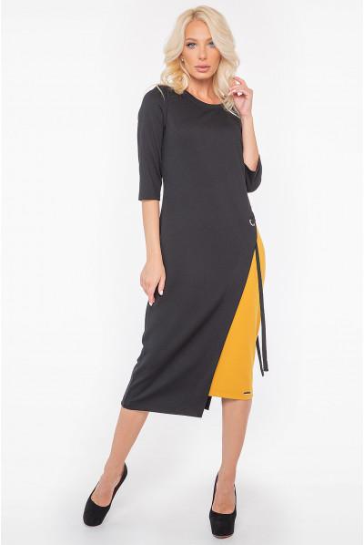 Чорно-гірчична трикотажна актуальна сукня міді